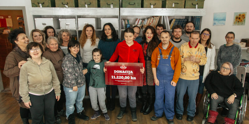 photo of a charity organization receiving a donation